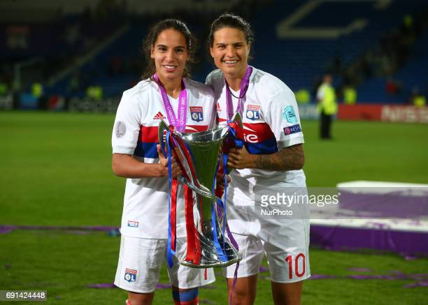 LR Amel Majri of Olympique Lyonnais Feminies and Dzsenifer Marozsan of Olympique Lyonnais Feminies with Trophy during the UEFA Women's Champions...