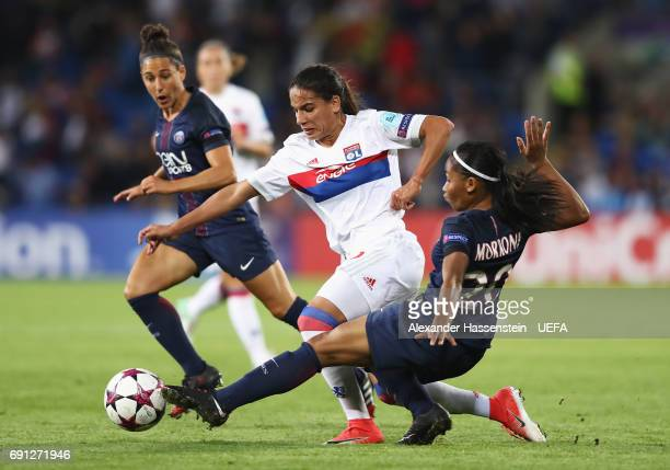 Amel Majri of Olympique Lyonnais takes on Perle Morroni and Veronica Boquete of Paris SaintGermain Feminines during the UEFA Women's Champions League...