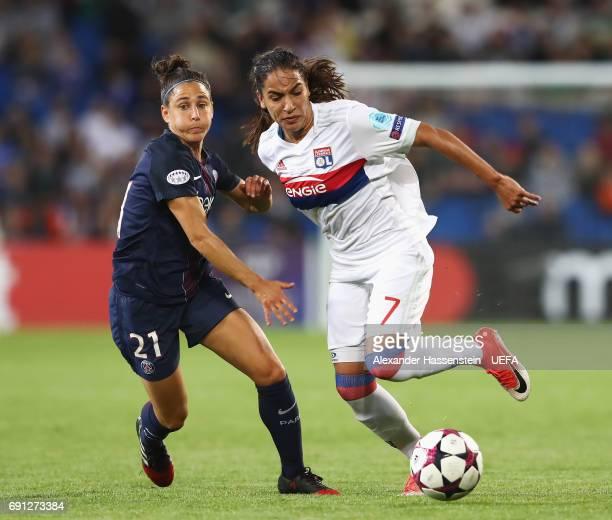 Amel Majri of Olympique Lyonnais takes on Veronica Boquete of Paris SaintGermain Feminines during the UEFA Women's Champions League Final between...