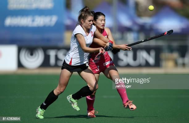 Amelia Katerla of Poland and Emi Nishikori of Japan battle for possession during day 4 of the FIH Hockey World League Semi Finals Pool B match...