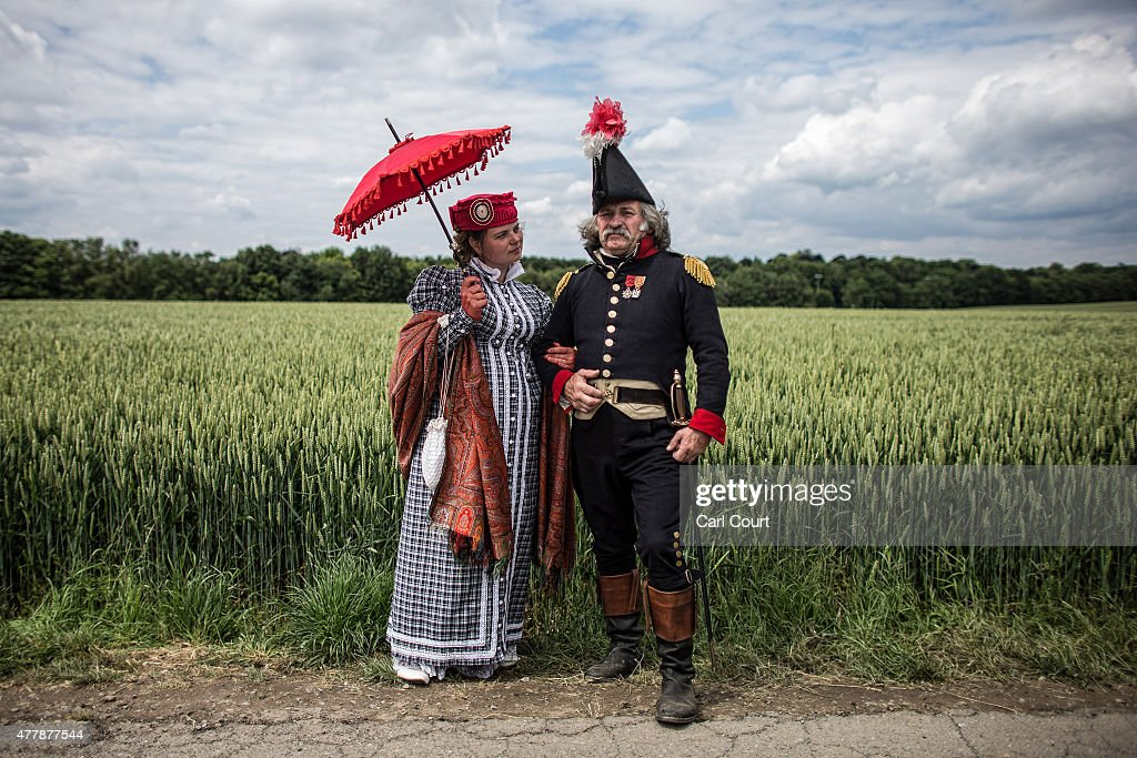 Amelia Klavel (L) from Moscow playing the role of a chaperone and Daniele Lorenzetti from Milan playing the role of a Major in the French Napoleonic army, pose for a photograph ahead of the second part of a large scale re-enactment of the battle of Waterloo, to mark it's bicentenary on June 20, 2015 in Waterloo, Belgium. Around 5000 historical re-enactors will amass over two evenings to re-enact the two stages of the battle in front of around 200,000 spectators from around the world. The first evening will see the 'French Attack', followed on the next day by the 'The Allied Counter attack'. The events will mark the battle of 1815 which saw the overthrow of Napoleon Bonaparte and the restoration of Louis XVIII to the French throne.