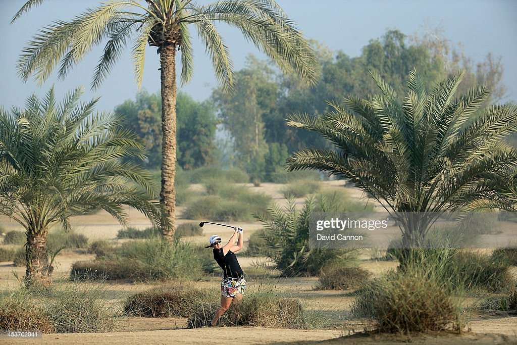 Amelia Lewis of the USA plays her third shot on the par 5, 10th hole during the second round of the 2013 Omega Dubai Ladies Masters on the Majilis Course at the Emirates Golf Club on December 5, 2013 in Dubai, United Arab Emirates.