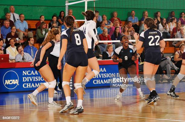 Amelia McCall celebrates with teammates after scoring a point against Calvin College during the Division III Women's Volleyball Championship held at...