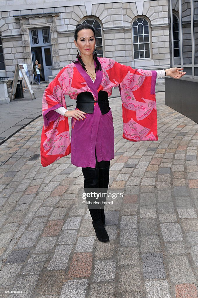Amelia Powers, Urban Shaman, Bag Designer, wearing Vintage kimono, black leather vintage obi and jeans and black swede boots at London Fashion Week Autumn/Winter 2012 at on February 21, 2012 in London, England.