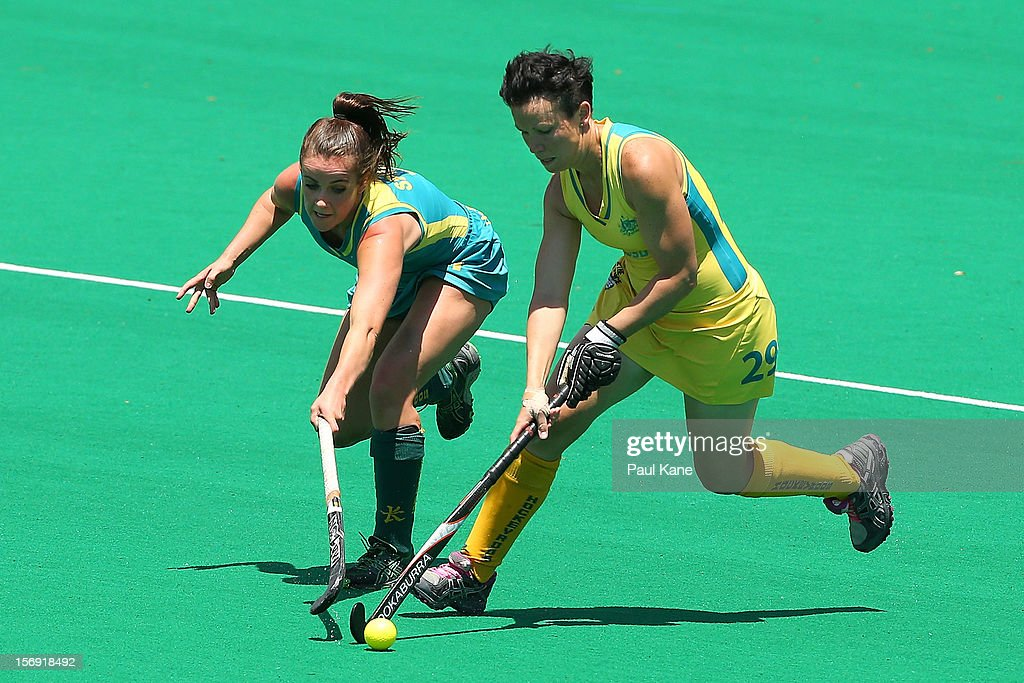 Amelia Spence of the Jillaroos and Teneal Attard of the Hockeyroos contest for the ball in the gold medal match between the Australian Hockeyroos and the Australian Jillaroos during day four of the 2012 International Super Series at Perth Hockey Stadium on November 25, 2012 in Perth, Australia.