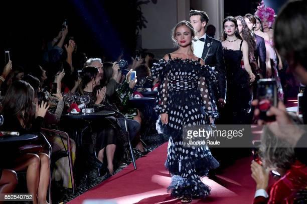 Amelia Windsor Cameron Dallas and Sonia Ben Ammar walk the runway at the Dolce Gabbana secret show during Milan Fashion Week Spring/Summer 2018 at...