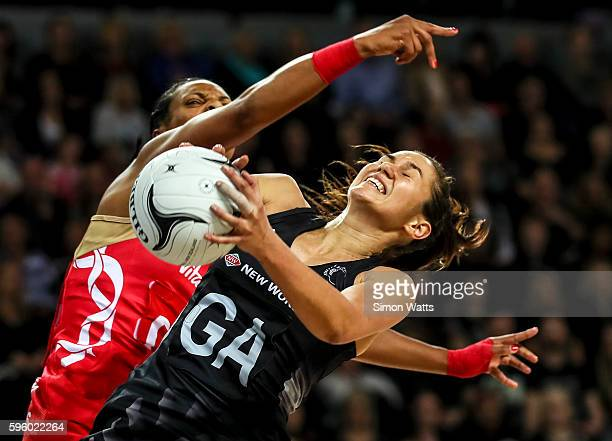 Ameliaranne Ekenasio of New Zealand takes a pass under pressure from Stacey Francis of England during the International Test Match between New...