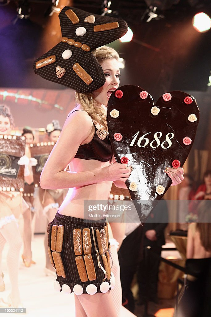 Amelie Klever wearing creations out of Cake packagins by artist Larisa Katz Art couture walks the catwalk during the Lambertz Monday Night at Alter Wartesaal on January 28, 2013 in Cologne, Germany.