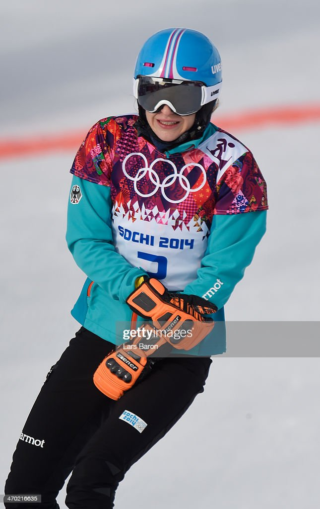 <a gi-track='captionPersonalityLinkClicked' href=/galleries/search?phrase=Amelie+Kober&family=editorial&specificpeople=869316 ng-click='$event.stopPropagation()'>Amelie Kober</a> of Germany holds her arm after being injured in the Snowboard Ladies' Parallel Giant Slalom Qualification on day twelve of the 2014 Winter Olympics at Rosa Khutor Extreme Park on February 19, 2014 in Sochi, Russia.