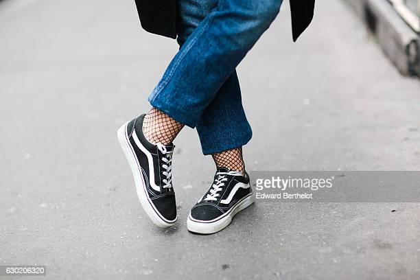 Amelie Lloyd fashion and life style blogger wears Sandro blue denim jeans Vans shoes HM fishnet socks black bras a Zara mesh top and a Zara long coat...