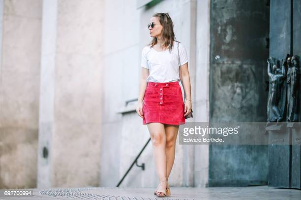 Amelie Lloyd fashion blogger wears a Courreges pink red velvet skirt a Maison Scotch white top a Valentino Rockstud bag and Zara sandals at Palais de...