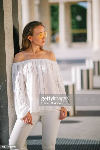 Amelie Lloyd fashion blogger wears a Jennyfer lace white top Jennyfer white pants and Jennyfer silver shoes on May 21 2017 in Paris France