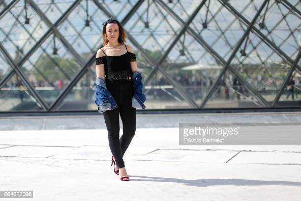 Amelie Lloyd fashion blogger wears Sandro black jeans a Bershka black lace off shoulder top a vintage blue denim jacket and New Look shoes at the...