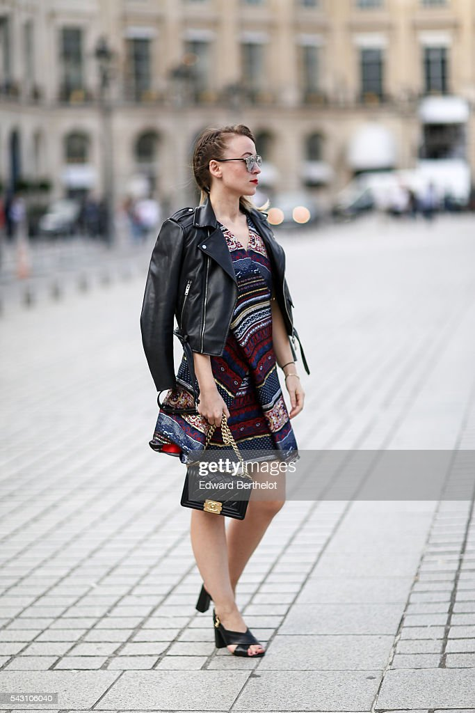 Amelie Lloyd is wearing a Kenzo dress, Dior sunglasses, a Chanel bag, and Minelli shoes, after the Henrik Vibskov show, during Paris Fashion Week Menswear Spring/summer 2017, on June 25, 2016 in Paris, France.