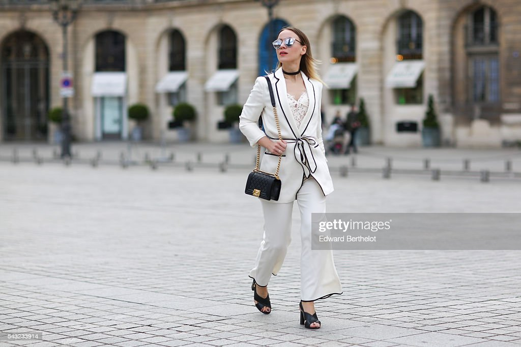 Amelie Lloyd is wearing a Zara full outfit, Dior sunglasses, a Chanel bag, and Minelli shoes, before the Sean Suen show, during Paris Fashion Week Menswear Spring/summer 2017, on June 26, 2016 in Paris, France.