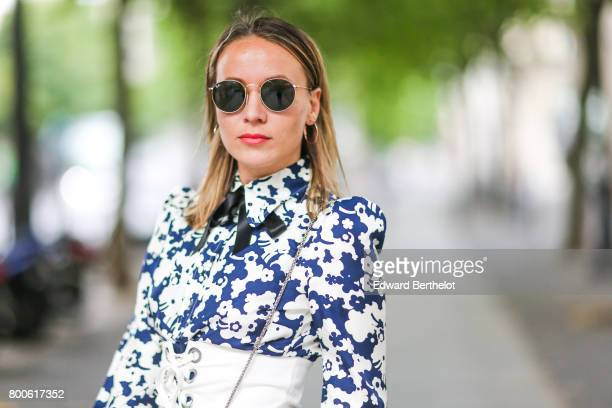Amelie Lloyd wears sunglasses a Marc Jacobs flower print dress a white corset a Furla bag during Paris Fashion Week Menswear Spring/Summer 2018 on...