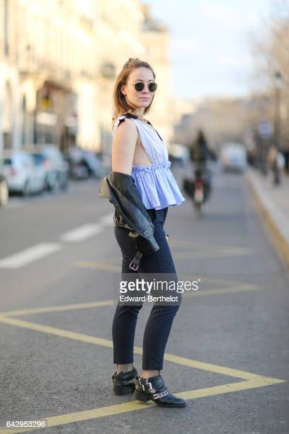Amelie Lloyd wears Zara pants a Zara off shoulder and low neck blue top Zara black shoes sunglasses a Valentino Rockstud bag and a black perfecto...
