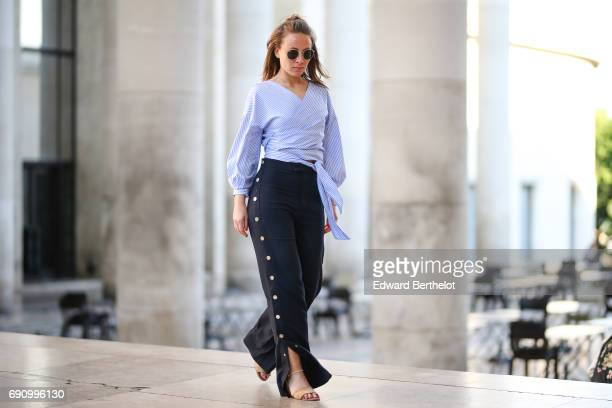 Amelie Lloyd wears Zara pants a Zara striped top and Zara shoes at Palais de Tokyo on May 30 2017 in Paris France