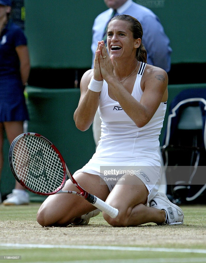 Amelie Mauresmo falls to the ground after winning the Ladies' championship by defeating <a gi-track='captionPersonalityLinkClicked' href=/galleries/search?phrase=Justine+Henin&family=editorial&specificpeople=157479 ng-click='$event.stopPropagation()'>Justine Henin</a>-Hardenne in the 2006 Wimbledon Championships at the All-England Lawn Tennis & Croquet Club, July 8, 2006, London. Mauresmo won 2-6, 6-3, 6-4.