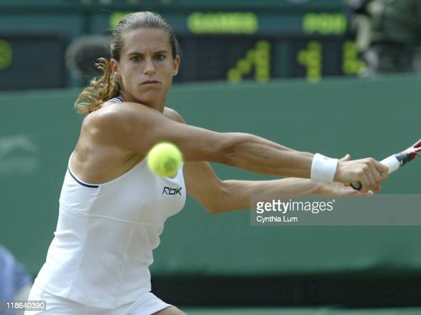 Amelie Mauresmo hits a return versus Justine HeninHardenne in the Ladies Finals of the 2006 Wimbledon Championships at the All England Lawn Tennis...