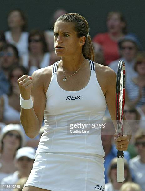 Amelie Mauresmo hits a winner versus Justine HeninHardenne in the Ladies Finals of the 2006 Wimbledon Championships at the All England Lawn Tennis...