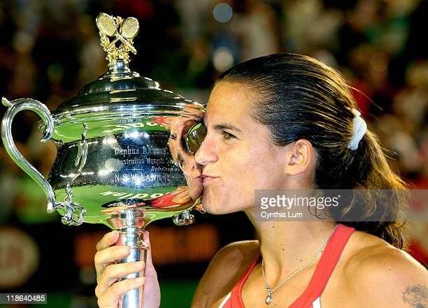 Amelie Mauresmo kisses the trophy after beating Justine HeninHardenne in the women's singles final at the 2006 Australian Open at Melbourne Park in...