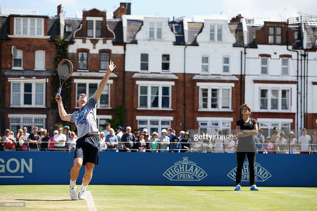 Amelie Mauresmo looks on as Andy Murray of Great Britain warms up on the practice courts on day three of the Aegon Championships at Queens Club on June 11, 2014 in London, England.