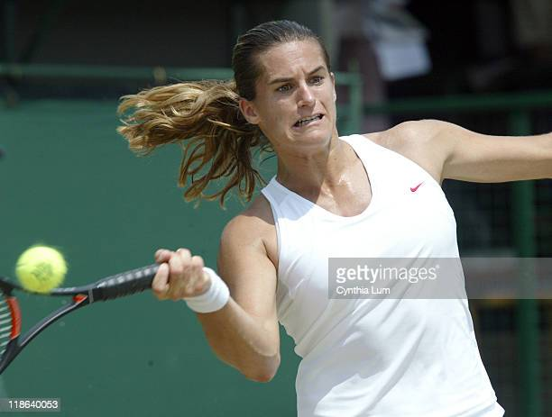Amelie Mauresmo of France advances to the quarter finals with a 75 62 win over Silvia Farina Elia of Italy in the fourth round of the 2004 Wimbledon...