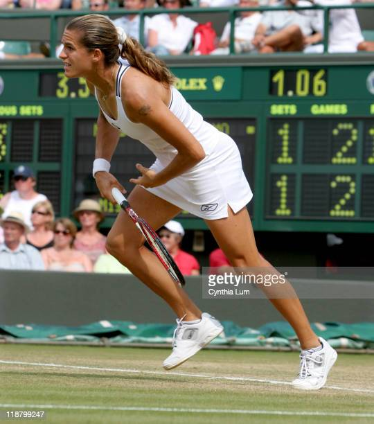 Amelie Mauresmo of France defeating Anastasia Myskina of Russia 61 36 63 in the quarterfinal of the Wimbledon Championships at the All England Lawn...