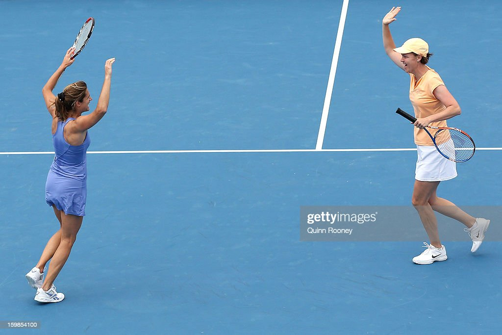 Amelie Mauresmo of France fives with Lindsay Davenport of the United States in her third round legends doubles match against Nicole Bradtke of Australia and Rennae Stubbs of Australia during day nine of the 2013 Australian Open at Melbourne Park on January 22, 2013 in Melbourne, Australia.