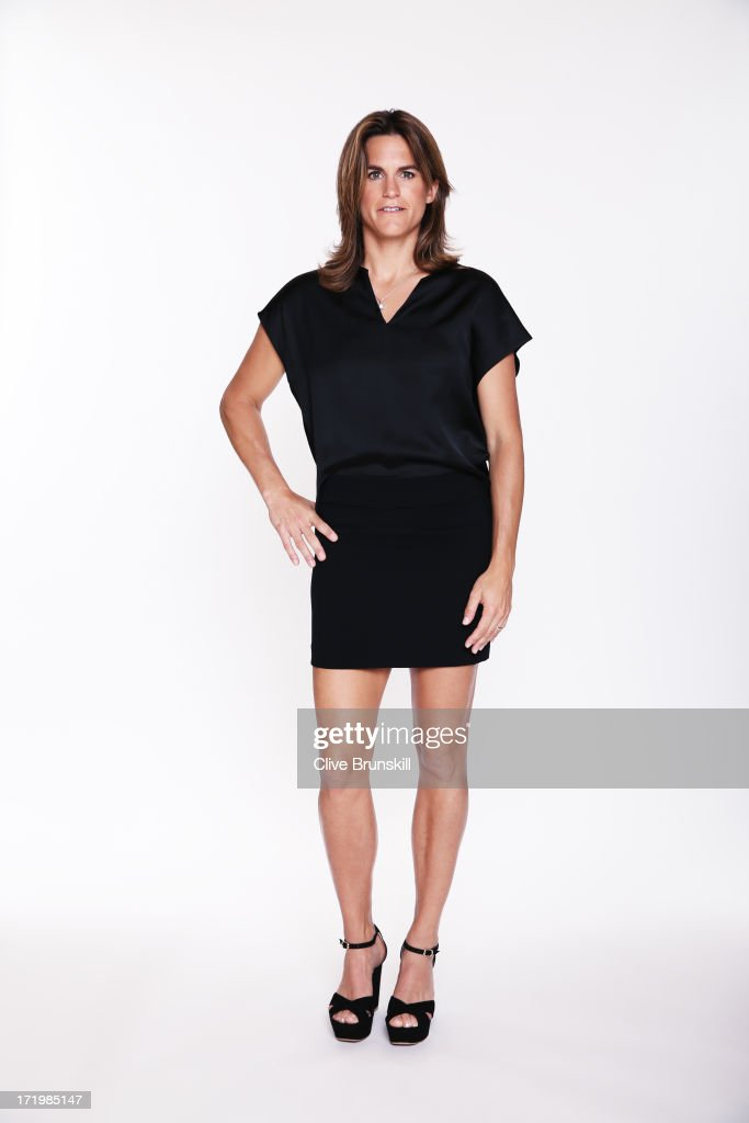This image has been retouched) <a gi-track='captionPersonalityLinkClicked' href=/galleries/search?phrase=Amelie+Mauresmo&family=editorial&specificpeople=161389 ng-click='$event.stopPropagation()'>Amelie Mauresmo</a> poses for an exclusive photoshoot during the WTA 40 Love Celebration on Middle Sunday of the Wimbledon Lawn Tennis Championships at the All England Lawn Tennis and Croquet Club at Wimbledon on June 30, 2013 in London, England.