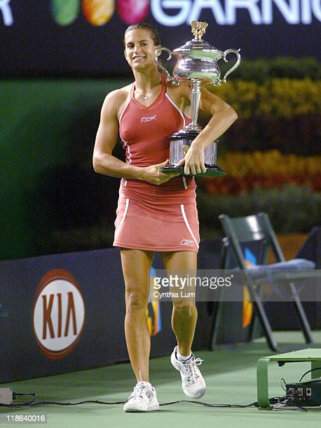 Amelie Mauresmo walks with the trophy after beating Justine HeninHardenne in the women's singles final at the 2006 Australian Open at Melbourne Park...