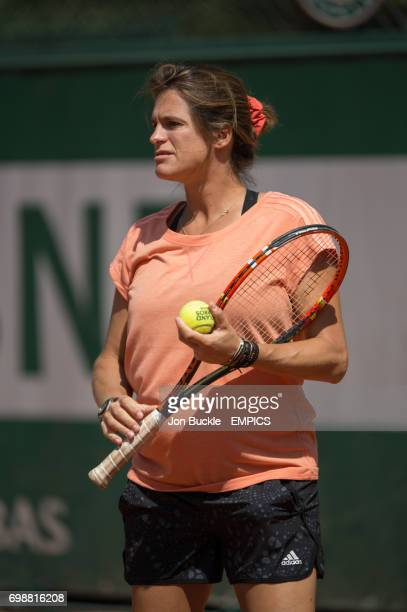 Amelie Mauresmo watches on as Andy Murray practices on day one of the French Open at Roland Garros on May 24 2015 in Paris France