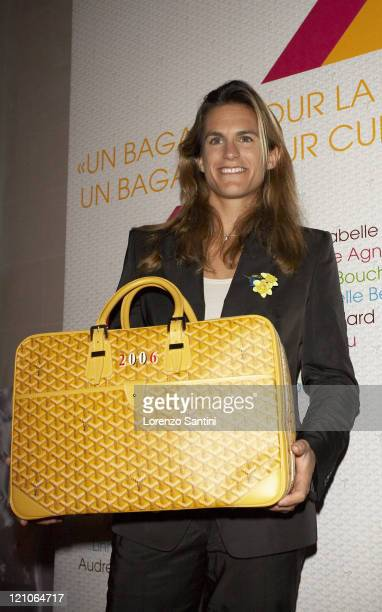 Amelie Mauresmo with the Goyard bag she designed during Auction of Goyard Handbags Designed by Celebrities for the 'Institut Curie' November 28 2006...
