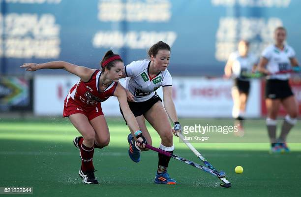 Amelie Wortmann of Germany battles with Erin Matson of United States of America during day 9 of the FIH Hockey World League Women's Semi Finals final...
