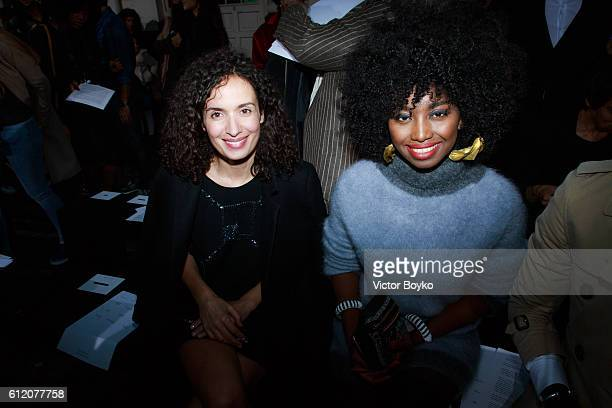 Amelle Chahbi and Inna Modja attend the John Galliano show as part of the Paris Fashion Week Womenswear Spring/Summer 2017 on October 2 2016 in Paris...