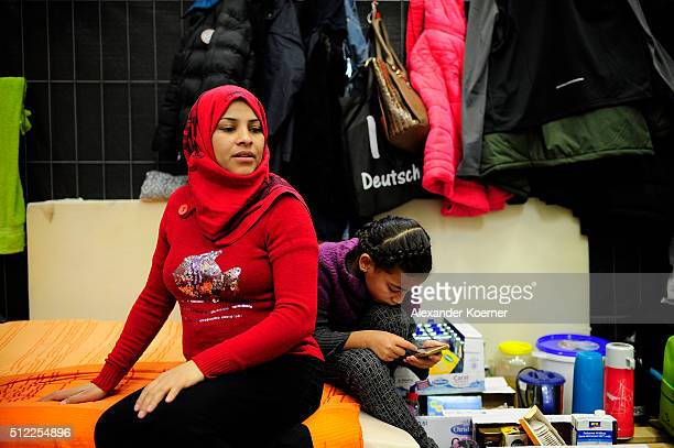 Amena Abdulhalim from Bagdad Iraq and Maram Hussin sit inside a shelter where they are living while their asylum applications are processed on...