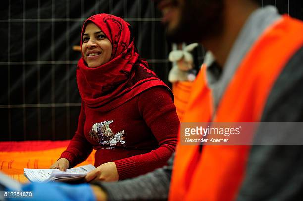 Amena Abdulhalim from Bagdad Iraq practices her German inside a shelter where they are living while their asylum applications are processed on...