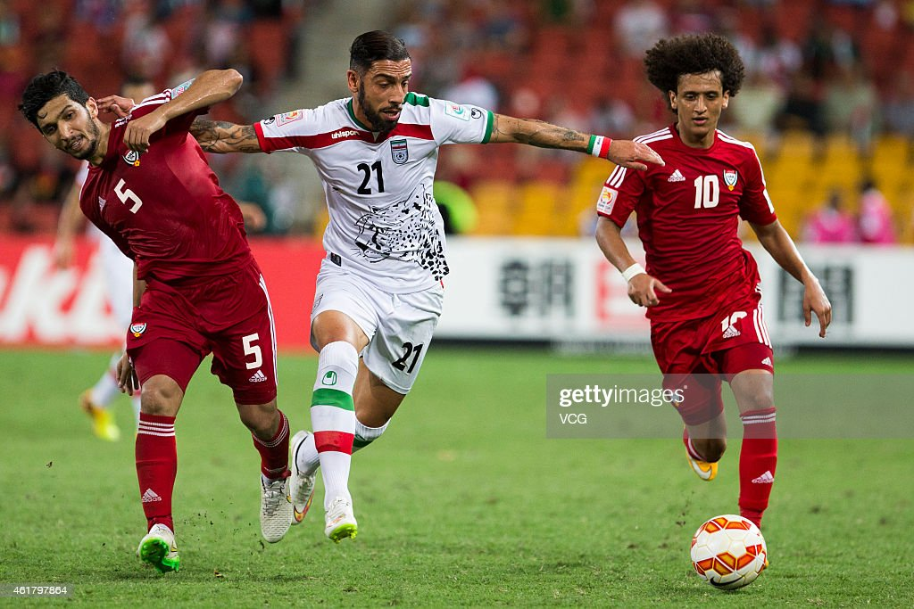 Amer Abdulrahman #5 the United Arab Emirates, <a gi-track='captionPersonalityLinkClicked' href=/galleries/search?phrase=Ashkan+Dejagah&family=editorial&specificpeople=4024305 ng-click='$event.stopPropagation()'>Ashkan Dejagah</a> #21 of Iran and <a gi-track='captionPersonalityLinkClicked' href=/galleries/search?phrase=Omar+Abdulrahman&family=editorial&specificpeople=6420654 ng-click='$event.stopPropagation()'>Omar Abdulrahman</a> #10 of the United Arab Emirates challenge for the ball during the 2015 Asian Cup match between IR Iran and the UAE at Suncorp Stadium on January 19, 2015 in Brisbane, Australia.