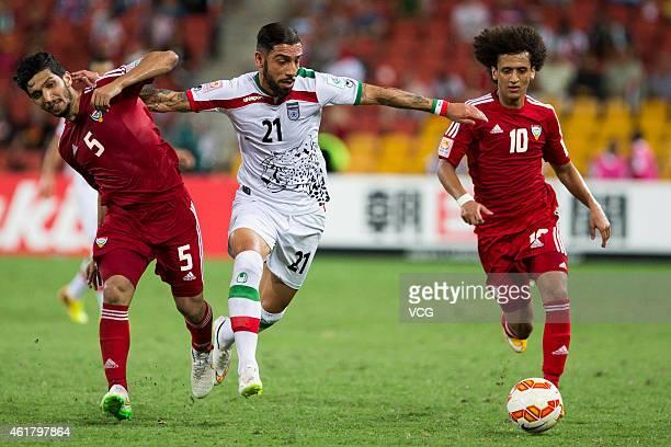 Amer Abdulrahman the United Arab Emirates Ashkan Dejagah of Iran and Omar Abdulrahman of the United Arab Emirates challenge for the ball during the...