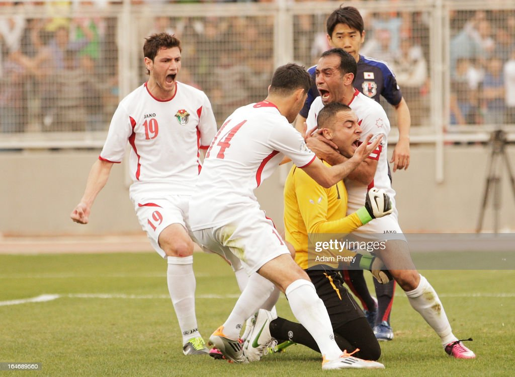 Amer Sabbah of Jordan is congratulated after saving a penalty during the FIFA World Cup Asian qualifier match between Jordan and Japan at King Abdullah International Stadium on March 26, 2013 in Amman, Jordan.