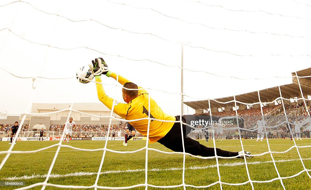 Amer Sabbah of Jordan saves a penalty kick from Yasuhito Endo of Japan during the FIFA World Cup Asian qualifier match between Jordan and Japan at King Abdullah International Stadium on March 26, 2013 in Amman, Jordan.