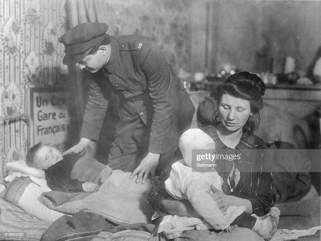 America aids the helplessMany were the homeless who found shelter from the war under American care This picture shows American Red Cross worker...