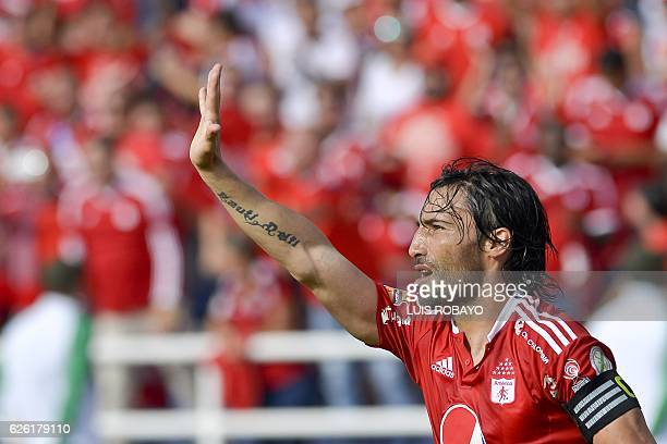 America de Cali's Ernesto Farias celebrates after scoring a goal scores against Deportes Quindio during a Colombian Professional Football tournament...