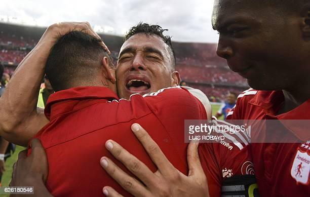 America de Cali's team player Camilo Ayala celebrates after defeating Deportes Quindio in a Colombian Professional Football tournament promotion...
