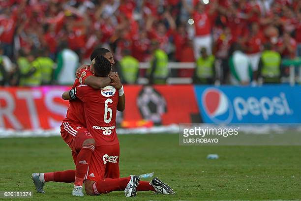 America de Cali's team players Camilo Ayala and Juan Angulo celebrate after defeating Deportes Quindio in a Colombian Professional Football...