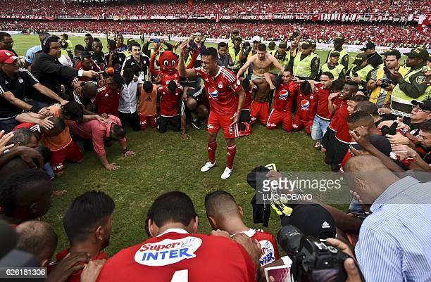 America de Cali's team players pray after defeating Deportes Quindio in a Colombian Professional Football tournament promotion match in Cali Colombia...