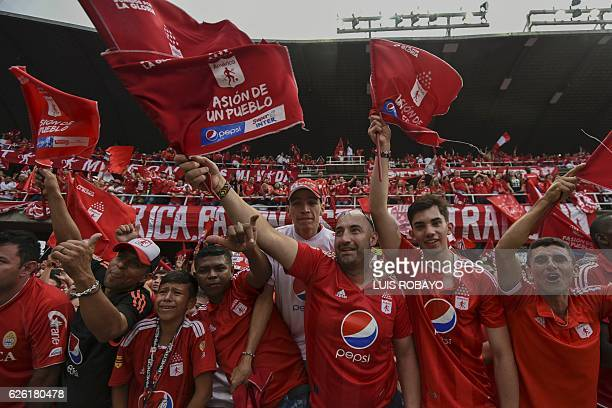 America de Cali's team supporters celebrate after their team defeated Deportes Quindio in a Colombian Professional Football tournament promotion...