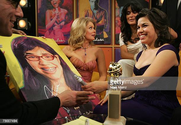 America Ferrera signs art work by pop artist Nicolosi on the Entertainment Tonight set after winning for the Best Performance by an Actress in a...