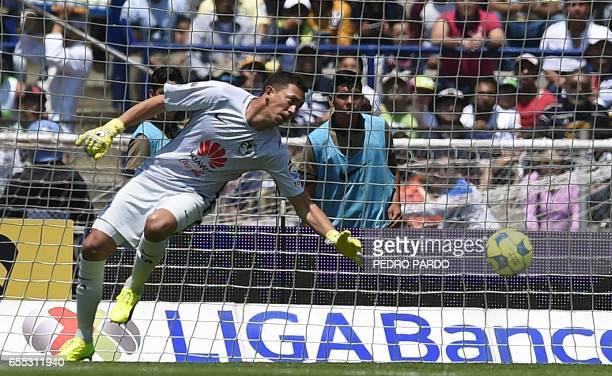 America goalkeeper Agustin Marchesin fails to stop a goal scored by Pumas' forward Nicolas Castillo during their Mexican Clausura tournament football...